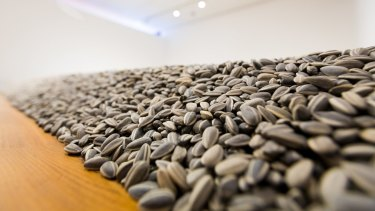 Notable artists such as Ai Weiwei, who created <i>Sunflower Seeds</I>, appear in the exhibition.