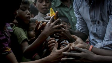 Rohingya refugees rush to relief supplies donated by the crew of the Nautical Aliya.