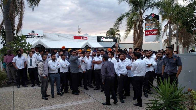Taxi drivers gather to pay their respects to the slain bus driver.