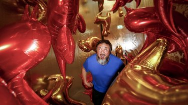Ai Weiwei visits his Caonima Balloon installation, part of the NGV's Andy Warhol / Ai Weiwei exhibition.