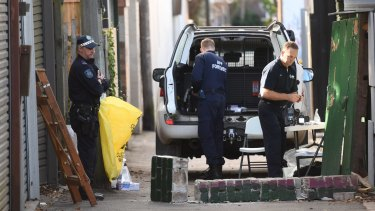 Police search a property in Surry Hills following the NSW Joint Counter Terrorism team raids throughout Sydney suburbs.