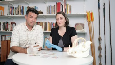 Griffith University archaeologists Associate Professor Adam Brumm and Dr Michelle Langley with some of the artefacts from the find.