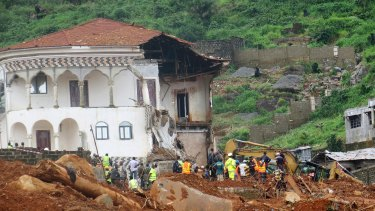 Volunteers search for bodies from the scene of heavy flooding and mudslides in Regent, just outside of Sierra Leone's capital Freetown last week.