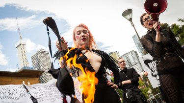 Ms Rodgers and Ms Bellentina burn a bra from Honey Birdette