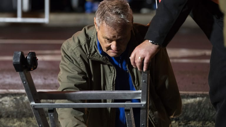 Artist Mike Parr emerges after 72 hours buried in a steel box underneath Hobart's Macquarie Street.