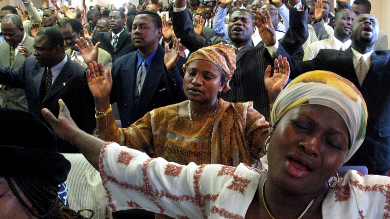 Migrants from Africa fill the Church of the Pentecost in the Bronx on Palm Sunday, 2004.