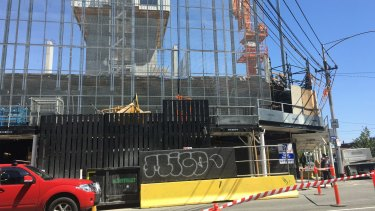 The man fell 20 metres from a  work platform at the site of a high rise apartment development in Carlton.