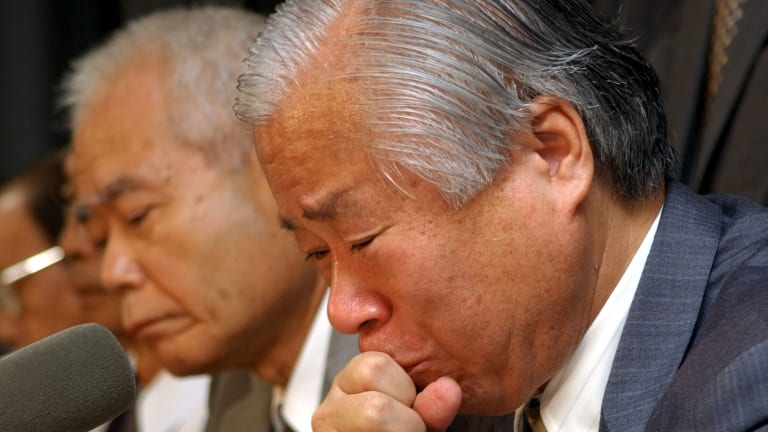 Megumi Yokota's father Shigeru, right,  weeps during a press conference in Tokyo in 2002 after North Korean authorities told a diplomatic mission from Japan that his daughter was dead.