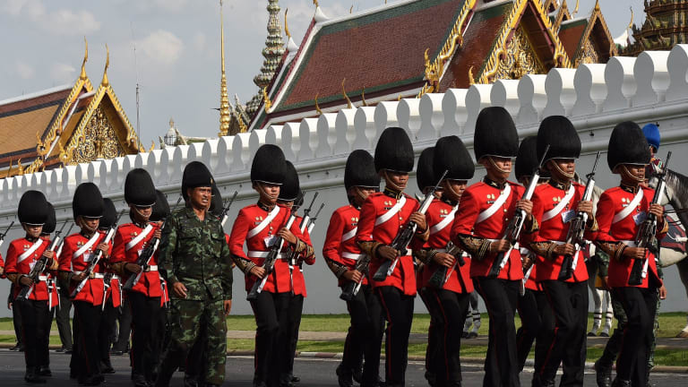 Guards outside the Grand Palace in Bangkok in preparation for the arrival of the body of Thailand's King Bhumibol Adulyadej.