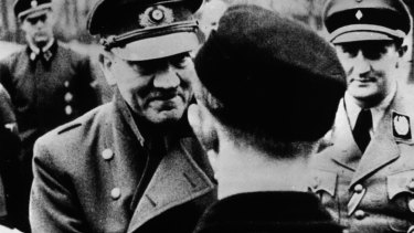In his last official photo, Adolf Hitler (1889-1945) leaves the safety of his bunker to award decorations to members of Hitler Youth.  As his reign began to collapse, there was a spate of army suicides within the Third Reich.