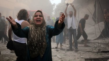 A Syrian woman mourns following an air strike by Assad government forces on the al-Mowasalat neighbourhood of the northern Syrian city of Aleppo on September 20.