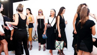 Model Lou Kenny (centre), pictured backstage, starred in the Vogue Runway at the Melbourne Fashion Festival on Wednesday night.