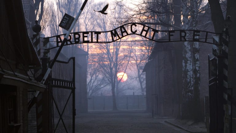 The main gate of the Nazi Auschwitz death camp at sunrise.