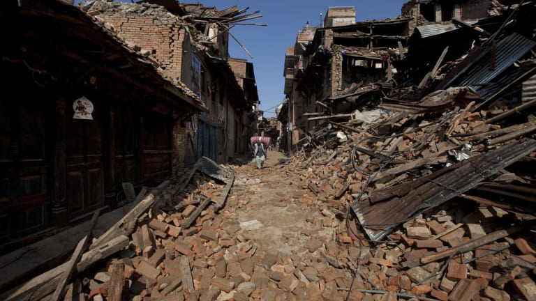 A Nepalese man walks through destruction caused by Saturday's earthquake in Bhaktapur.