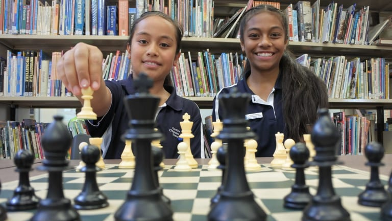 Sisters Imogen and Nicole Vea are following in their older siblings' footsteps, taking part in a national chess tournament with other students from Caroline Chisholm School.