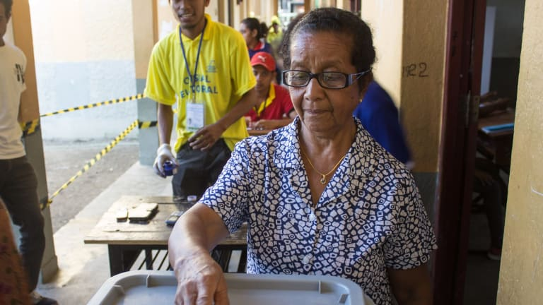 A woman casts her votes in East Timor's parliamentary elections on Saturday.