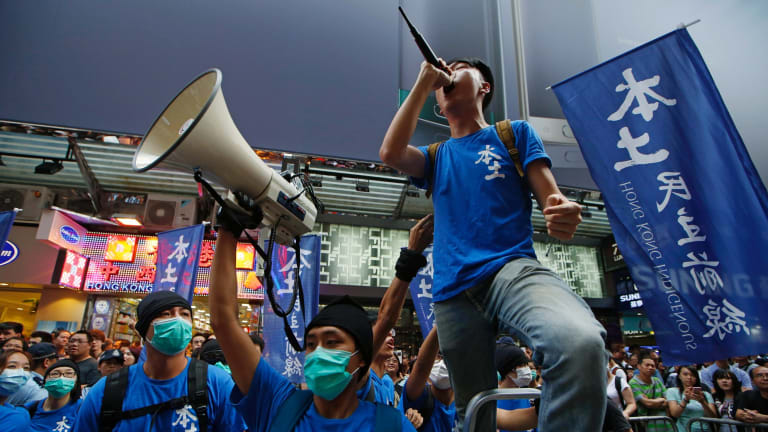 Edward Leung, with microphone, leading a demonstration by the Hong Kong Indigenous party in July 2015.