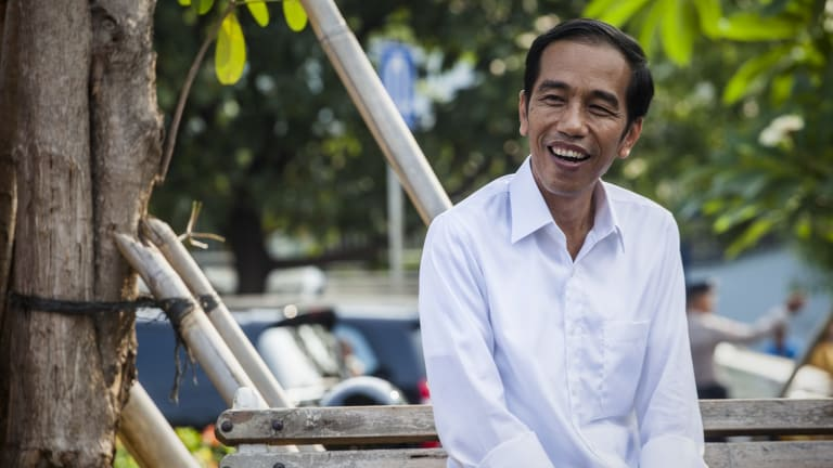 Indonesia presidential candidate Joko Widodo answers questions from journalists during an inspection of Pluit Reservoir in Jakarta.