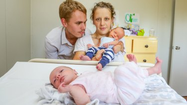 Danielle Weymark with her partner Mathew Johnson and their new born twins, Oliver and Lara. Danielle lost her left arm, right hand and most toes to meningitis as a baby.