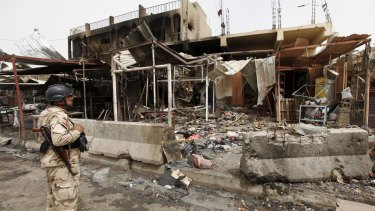 A member of the Iraqi security forces looks at the site of the Khan Bani Saad attack.
