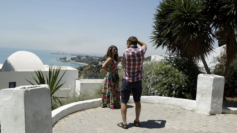 A tourist takes pictures of his partner in Sidi Bou Said, a popular tourist destination near Tunis, earlier this week.