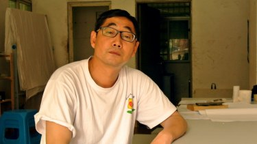 Activist Wu Guijun posing in his office in Shenzhen, south China's Guangdong province.