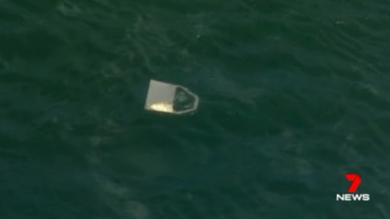 Debris seen floating in the river where the sea plane went down.