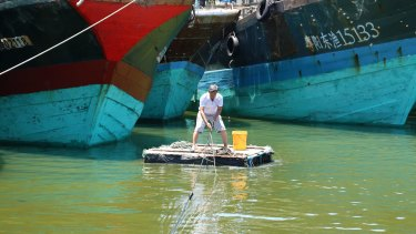 A fisherman at work in Tanmen, in China's southern Hainan Province.