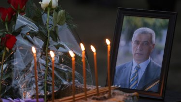 Flowers, candles and a picture of Kosovo Serb politician Oliver Ivanovic, who was assassinated.