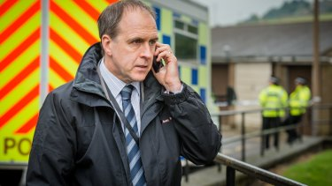 <i>Happy Valley's</i> harried police detective John Wadsworth (Kevin Doyle), trying to decipher a mumbled phone call.