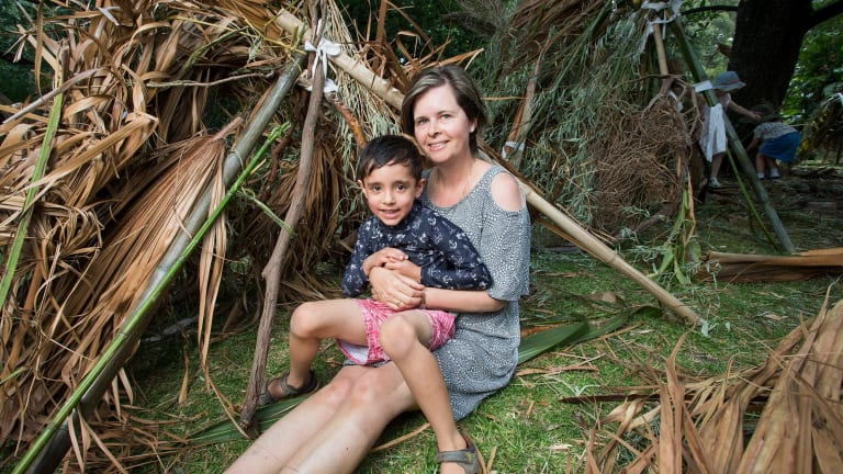 Angela Boyson and her son Oscar with their cubby at Melbourne's Royal Botanic Gardens.