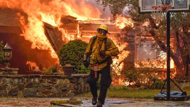 Firefighters work to extinguish a fire at a home in Anaheim Hills, California on Monday.