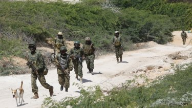 African Union soldiers patrol a district near the Somali capital, Mogadishu, after several al-shabab attacks in Mogadishu in recent days.