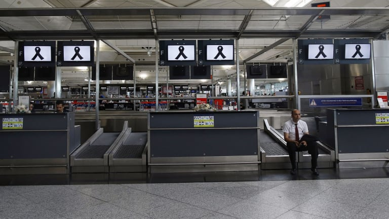 An official sits in Ataturk Airport in Istanbul ahead of a memorial event on June 30.