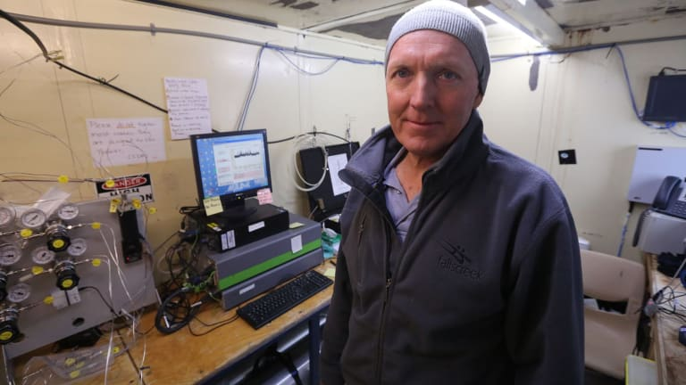 David Etheridge, from CSIRO's Oceans & Atmosphere division, at work in a research hut near the Antarctic base of Casey.