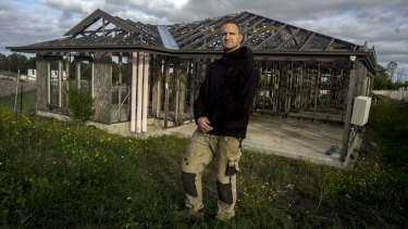 Draper in front of the unfinished property in Wallan.