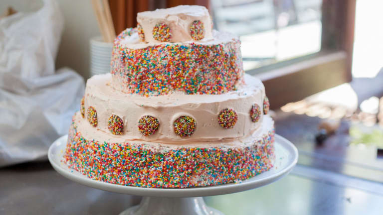It's a trade-off: buying a cake saves time, while making one saves money.