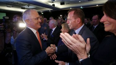 Mr Turnbull greets Mr Abbott before the launch.