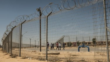 "Holot, in Israel's southern Negev desert, is an ""open prison"" where inmates can go out but need to be back before 10pm in order not to be transferred to a closed prison."