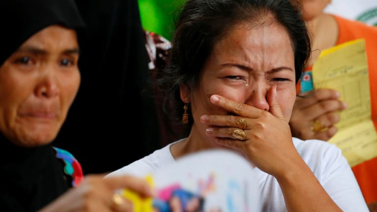 Displaced residents of Marawi cry upon receiving assurance of support from local officials at an evacuation centre in southern Philippines on Wednesday.