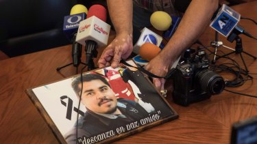 An image of slain Mexican journalist Edgar Daniel Esqueda Castro, in protest, before the start of a press conference about his death.