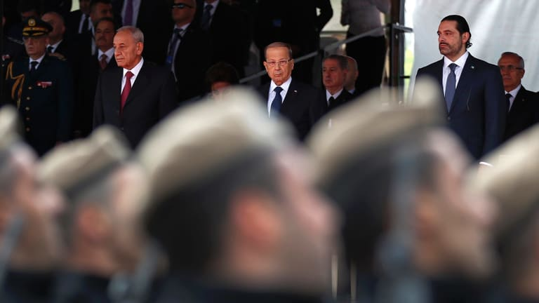 Parliament Speaker Berri, President Aoun and Lebanese PM Hariri attend a military parade to mark the 74th anniversary of Lebanon's independence from France.