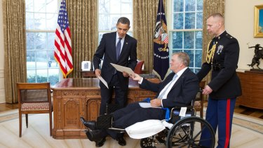 President Barack Obama exchanges credentials with Kim Beazley, the incoming ambassador from Australia, in the Oval Office in 2010.