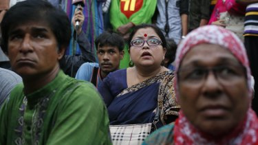 Bangladeshi students and social activists participate in a protest against the killing of a blogger Niloy Neel.