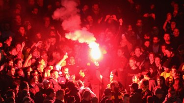 A flare is set off during the match.