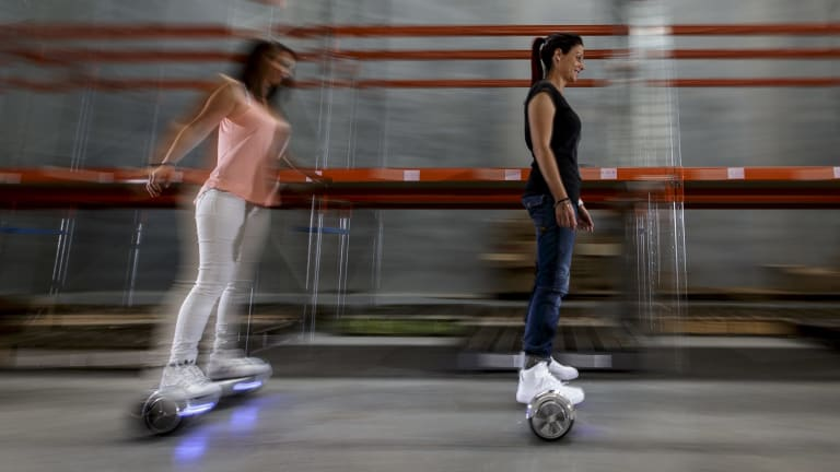 Paulina Ciurzynska and Laeyna Rillotta hoverboard their way around the Future Wheels warehouse in Bayswater.