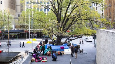 The homeless camp set up at the corner of Swanston and Collins street last month.
