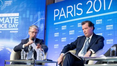 Jean-Laurent Bonnafe, chief executive officer of BNP Paribas , left, and Laurent Mignon, chief executive officer of Natixis  at one of the summit's side events on Monday.