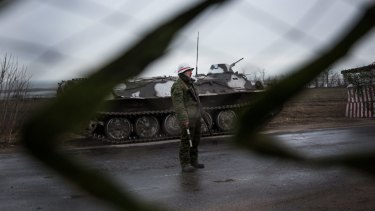 A pro-Russian rebel guards a checkpoint into the eastern Ukraine town of Novoazovsk.