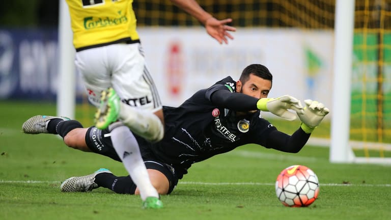 Shot stopper: Paul Izzo saves a goal during the round five A-League match between the Central Coast Mariners and the Wellington Phoenix at Central Coast Stadium.